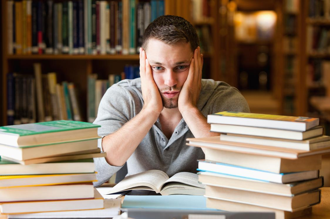 Depressed student having a lot to read